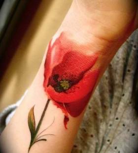 Lovely poppy flower tattoo on hand