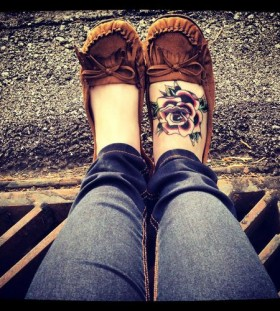 Lovely red roses tattoo with shoes