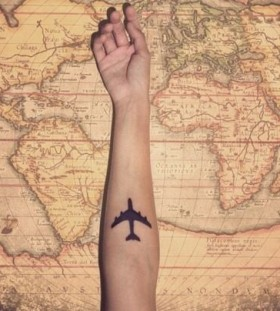 Lovely travels and plane map tattoo on arm