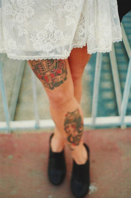 Lovely white dress and lace tattoo on leg