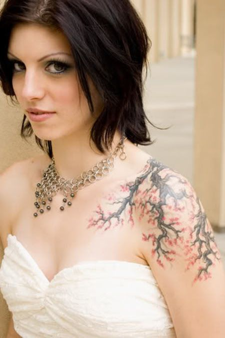 Lovely woman red tree tattoo on shoulder
