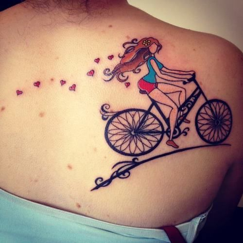 Lovely women hair and bicycle tattoo on back