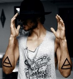 Man with big triangles tattoos