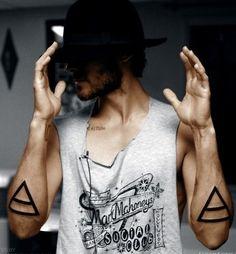 Man with big triangles tattoos