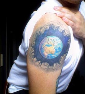 Man with globe tattoo on arm