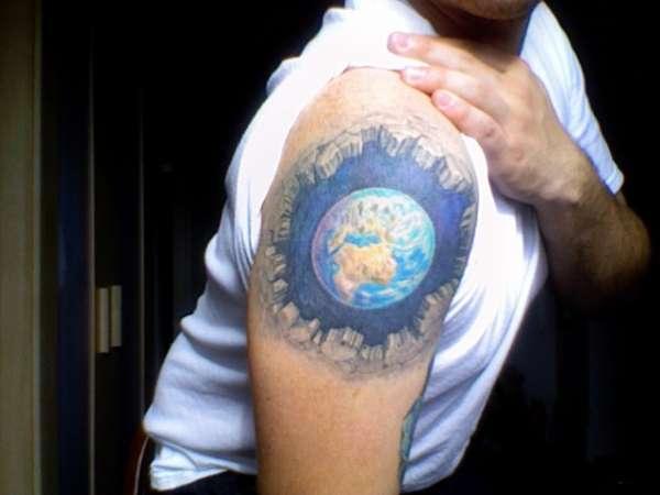 Man with globe tattoo on arm