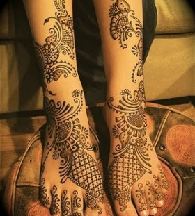 Mandala style black tribal tattoo on leg