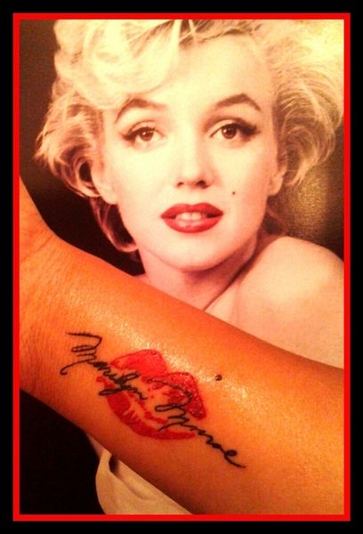 Marilyn Monroe and lips tattoo on arm