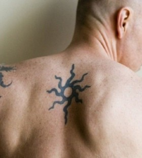Men's black back sun tattoo