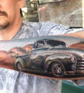 Men's lovely car tattoo on arm