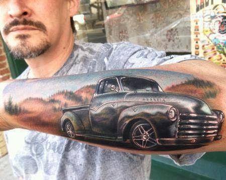 Men's lovely car tattoo on arm
