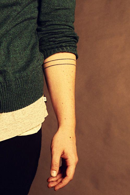 Minimal design line tattoo on arm