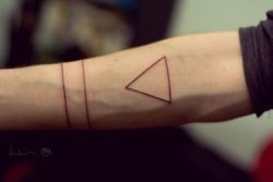 Minimal triangle line tattoo on arm