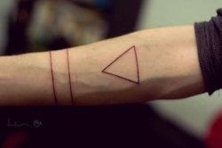 Minimal triangle line tattoo on arm