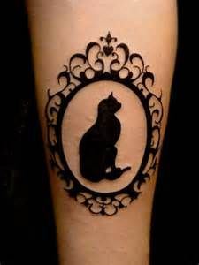 Mirrot and black cat tattoo on leg