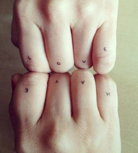 Modern style quote tattoo on finger