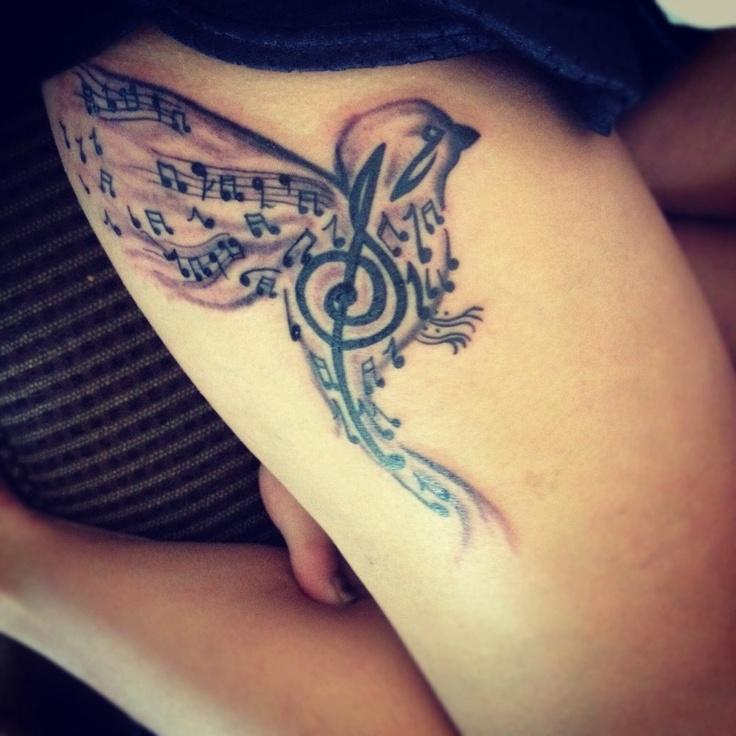 Music style bird tattoo on leg