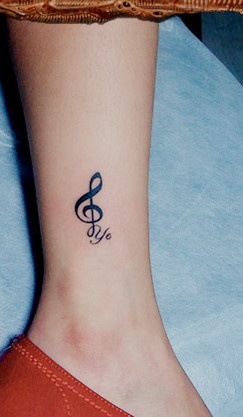Music style quote tattoo on leg