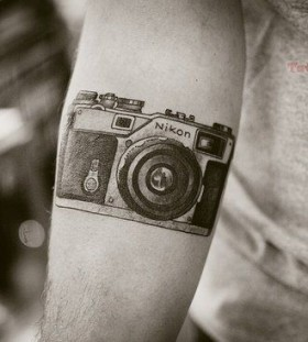 NIkon awesome camera tattoo on arm