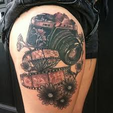 Nikon awesome camera tattoo on leg