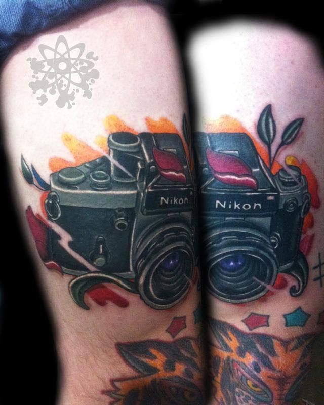 Nikon black and awesome camera tattoo on leg