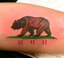 Numbers and California bear tattoo on arm