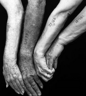 Numbers tattoos on old people hand