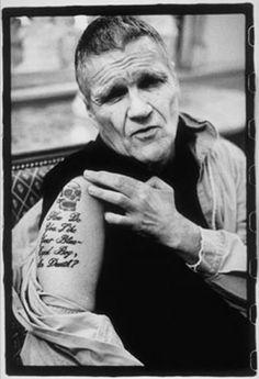 Old men's skull eye tattoo on shoulder