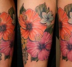 Orange and pink hawaiian style tattoo