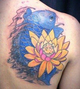 Orange flower and blue fish tattoo on arm