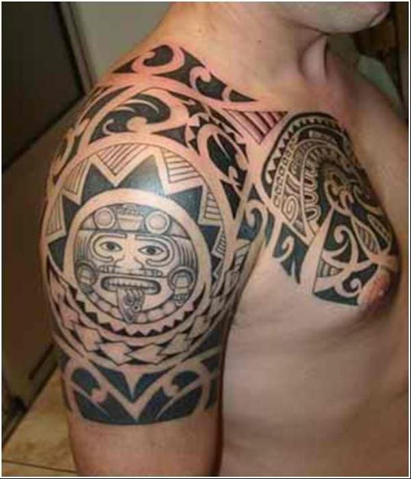 Ornaments and men's sun tattoo on arm