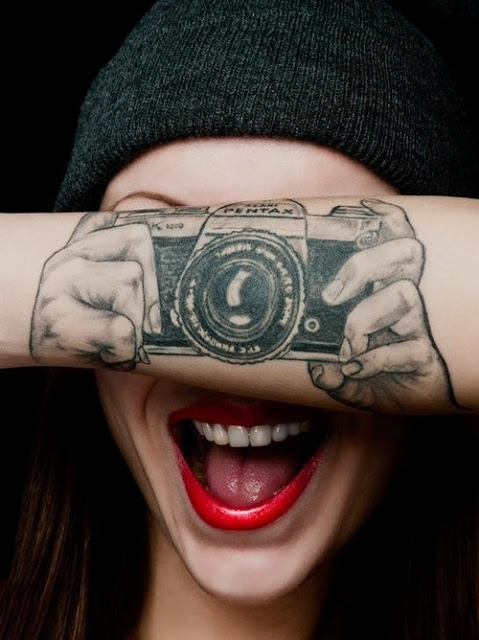 Pentax lovely camera tattoo on arm
