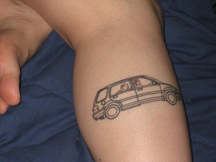 Peoples inside black funny car tattoo on leg