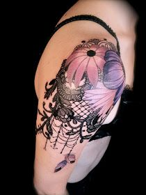 Pink and purple lace tattoo on arm