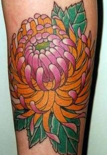 Pink flower tattoo on leg