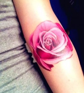 Pink lovely rose tattoo on arm