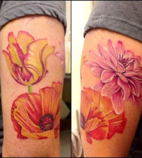 Pink, yellow and orange poppy tattoo on arm