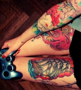 Playstation and girl ship tattoo on leg