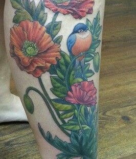 Poppy and blue bird tattoo on leg