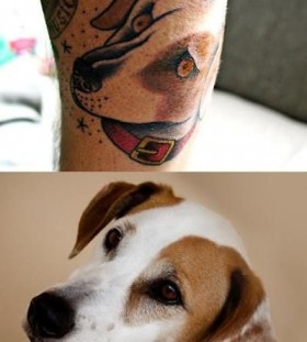 Portrait of realistic dog tattoo on leg