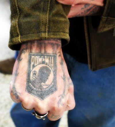Pow Da black soldier tattoo on arm