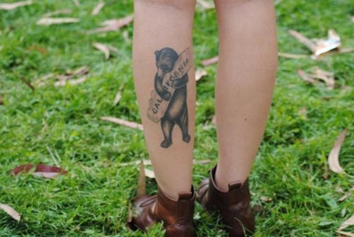 Pretty black california bear tattoo on leg