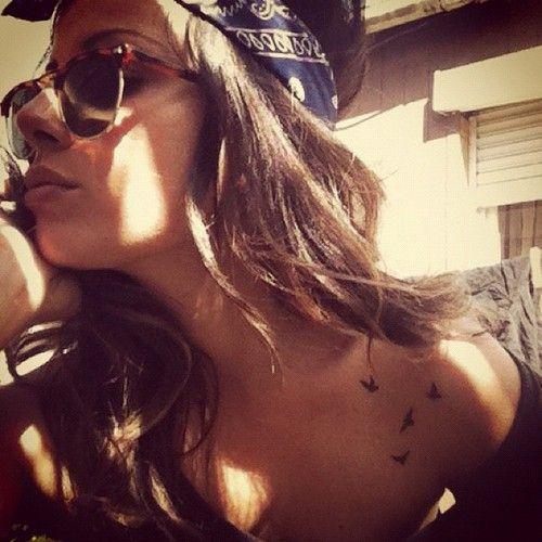 Pretty girl bird tattoo on shoulder