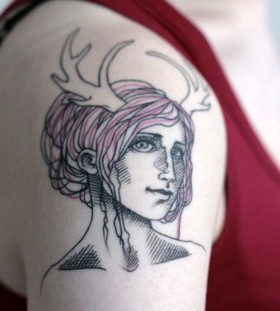Pretty girl face tattoo on arm