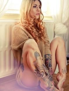 Pretty girl face tattoo on leg