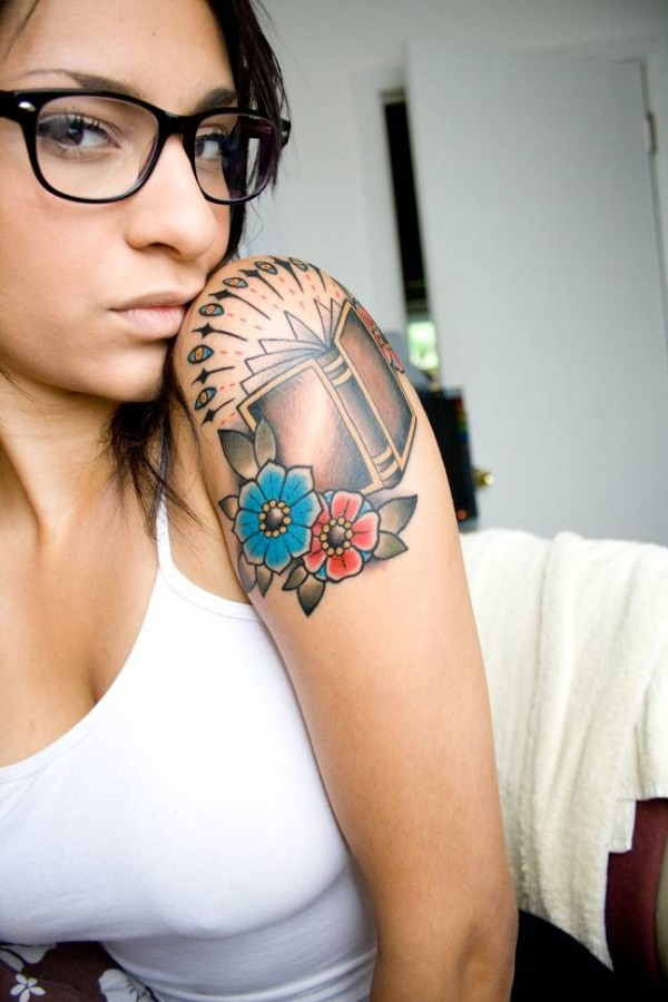 Pretty girl with glasses book tattoo on arm