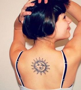 Pretty girl's back moon tattoo