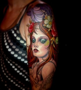 Pretty red hair girl's face tattoo on arm