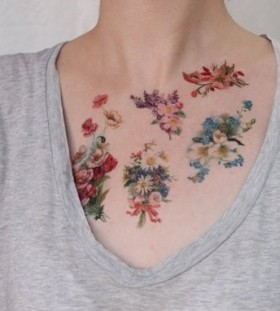 Pretty simple flower tattoo on chest