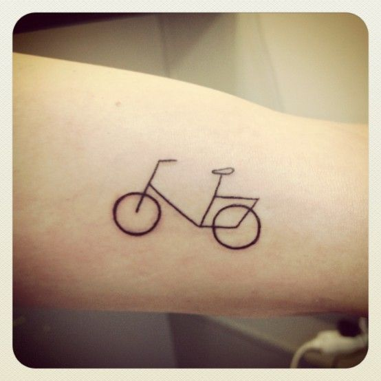 Pretty small bicycle tattoo on arm